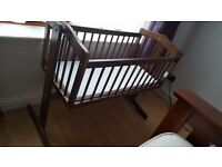 Lovely dark brown swinging crib and waterproof materess