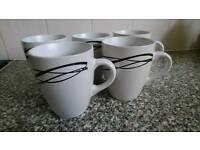 Set of 5 mugs - white and black