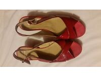 John Lewis like new red patent wedges. Size 7 and worn once indoors.