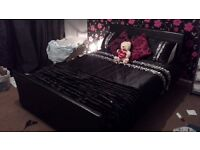 Black leather bed