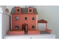 Vintage wooden dolls house with garage and garden