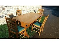 Long pine trestle table with 4 chairs