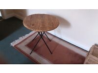 Cane top table with wrought iron legs