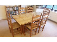 Pine Dining Table with a made-to-measure plate glass top & 6 Spanish-style pine chairs