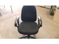 Black rotational office chairs with armrests