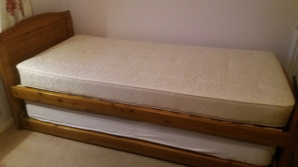 Single bed + pull out bed underneath + 2 matresses