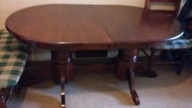 Solid wooden extandable dinning table with six free chairs
