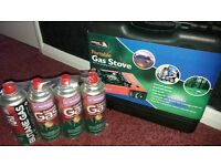 Portable gas stove and 4 gas canisters. Unused.