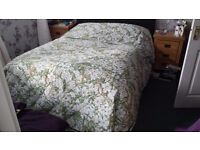 For sale double bed Sheridan quilt, green and white floral pattern £25
