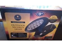 Outdoor security light (solar powered