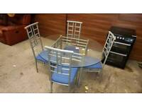 Glass and chrome table and 4 chairs