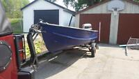 14 foot boat with 30Hp motor and trailer.