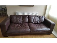 Brown leather sofa (3/4 seater) with matching foot stool and armchair