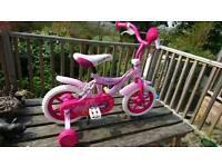 Pink and white 12 inch Angel bike