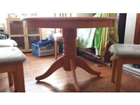 Pine table with 4 chairs still has protective plastic.never used.excellent condition..pick up only