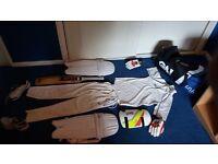 Full Cricket kit, including bag, bat, shirt, trousers, pads, thigh pad, gloves, shoes, hard ball