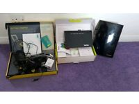 Two broadband routers and indoor tv amplifier Inc cables and filter