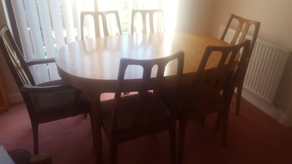 TEAK EXTENDABLE TABLE AND 6 CHAIRS