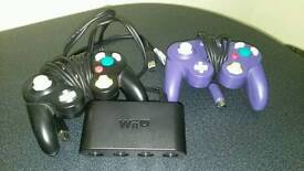Two gamecube controllers plus adapter for Wii U.