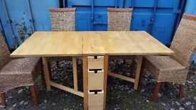 DROP LEAF TABLE WITH DRAWERS AND FOUR WICKER CHAIRS