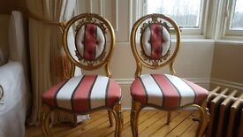 Antique gold painted hall or side chairs.