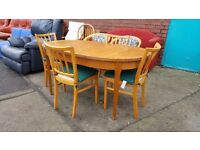 Light wood extending table and 4 chairs