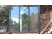 Anthracite Grey Aluminium Bi-Folding Doors and Double Window
