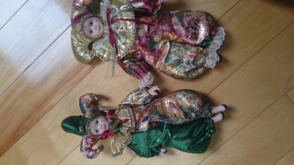 A set of Harlequin china/porcelain dolls