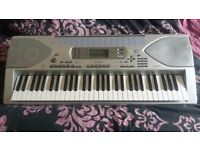Casio keyboard CTK691 full working order ideal for beginner and intermediate player with stand