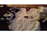 Taekwondo suit (size 130), one top size 120, helmet (small) arm pads and shin pads (xs)