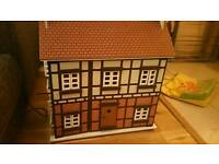 3 storey wooden dolls house with playmobil furniture