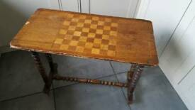 Old wooden chess top side table