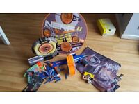 Selection of nerf guns, targets and darts