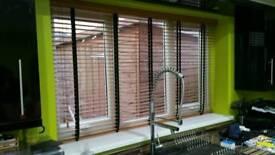 Wood slat blinds.
