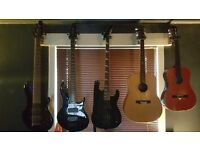 Peavey 6 string, same peavey in 5 string, Jackson 4 string and two acoustic guitars.