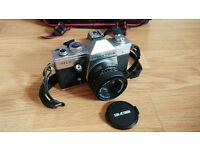 Praktica MTL3 Camera Auto Exposure. 35mm slr. c/w bag & many accessories. Proper old school!