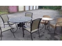 Two sets of garden table and chairs