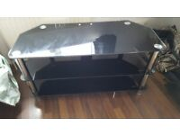 Black glass tv stand. 3 shelves. Good condition