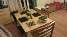 As new, dining table and 4 chairs