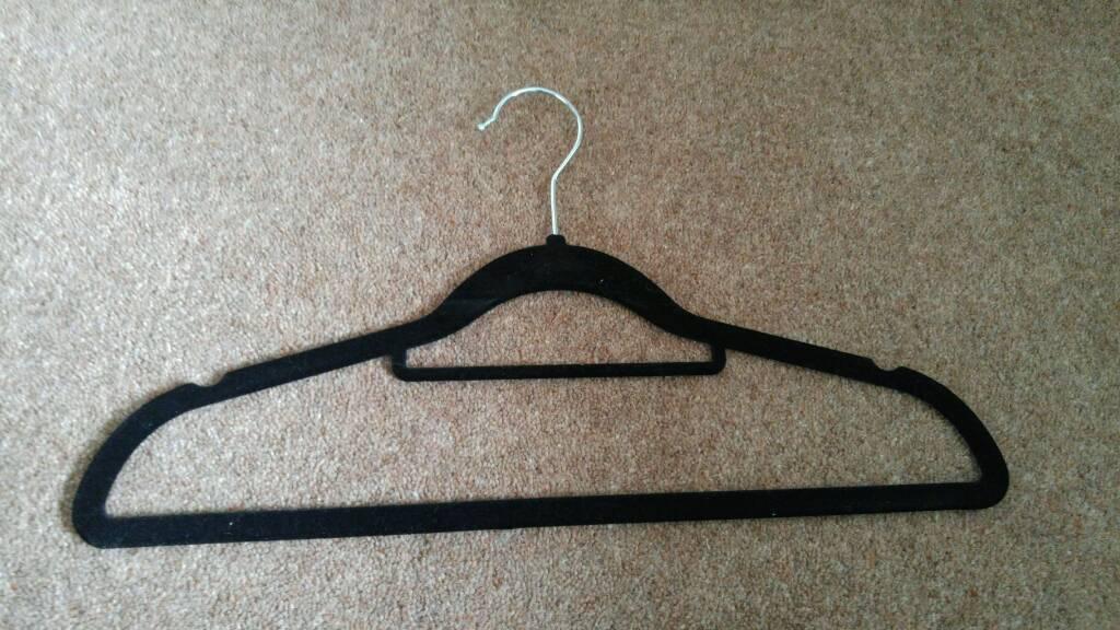 15 black and pink velvet hangers