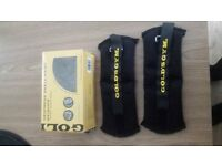 A pair of Gold gym ankle and wrist weights