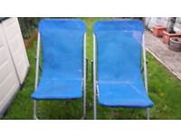 Low mesh deck lounger chairs.