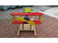 Kids rocker sit on wooden aeroplane