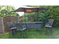 Out door bar with canopy and 4 swivel high chairs