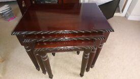 Nest of 3 mahogany tables