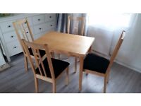 Extendable Ikea table with 4 chairs