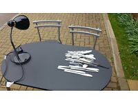 BLACK TABLE AND CHAIRS, BLACK LAMP AND CUTLERY IN GOOD CONDITION FOR SALE