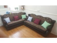 Sofa/settee . Decent condition settee nice brown flowral pattern
