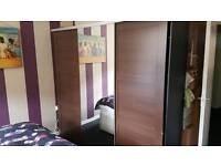 Mahogany IKEA mirrored wardrobe with sliding doors