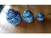 Set of three blue and white ceramic ginger jars with lids